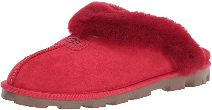 The slippers in bright red with fur around the foot, an open back, and seam down the front middle