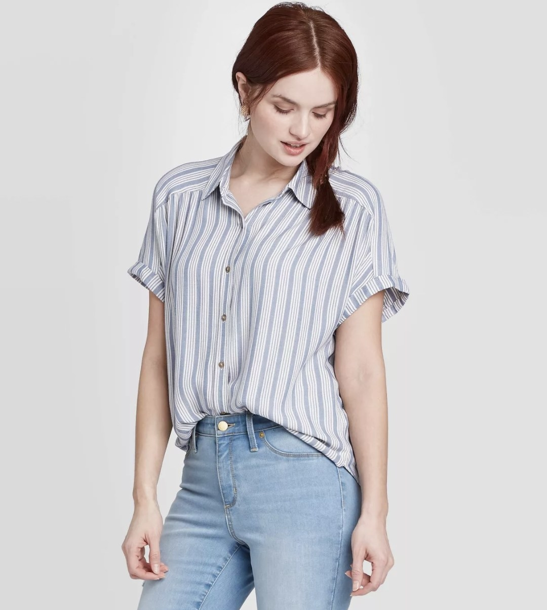 model wearing white and blue striped shirt