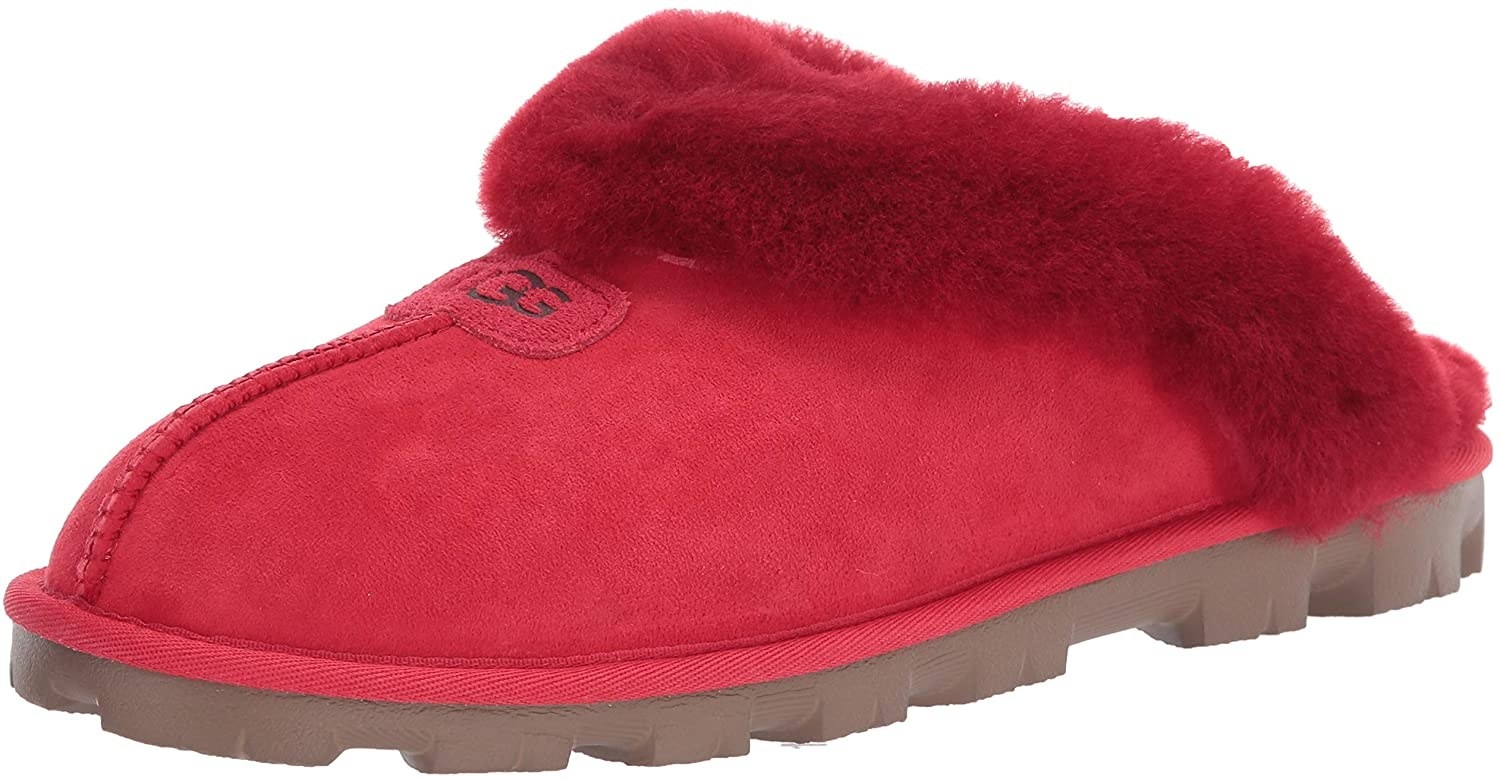 The backless slippers in red with shearling lining
