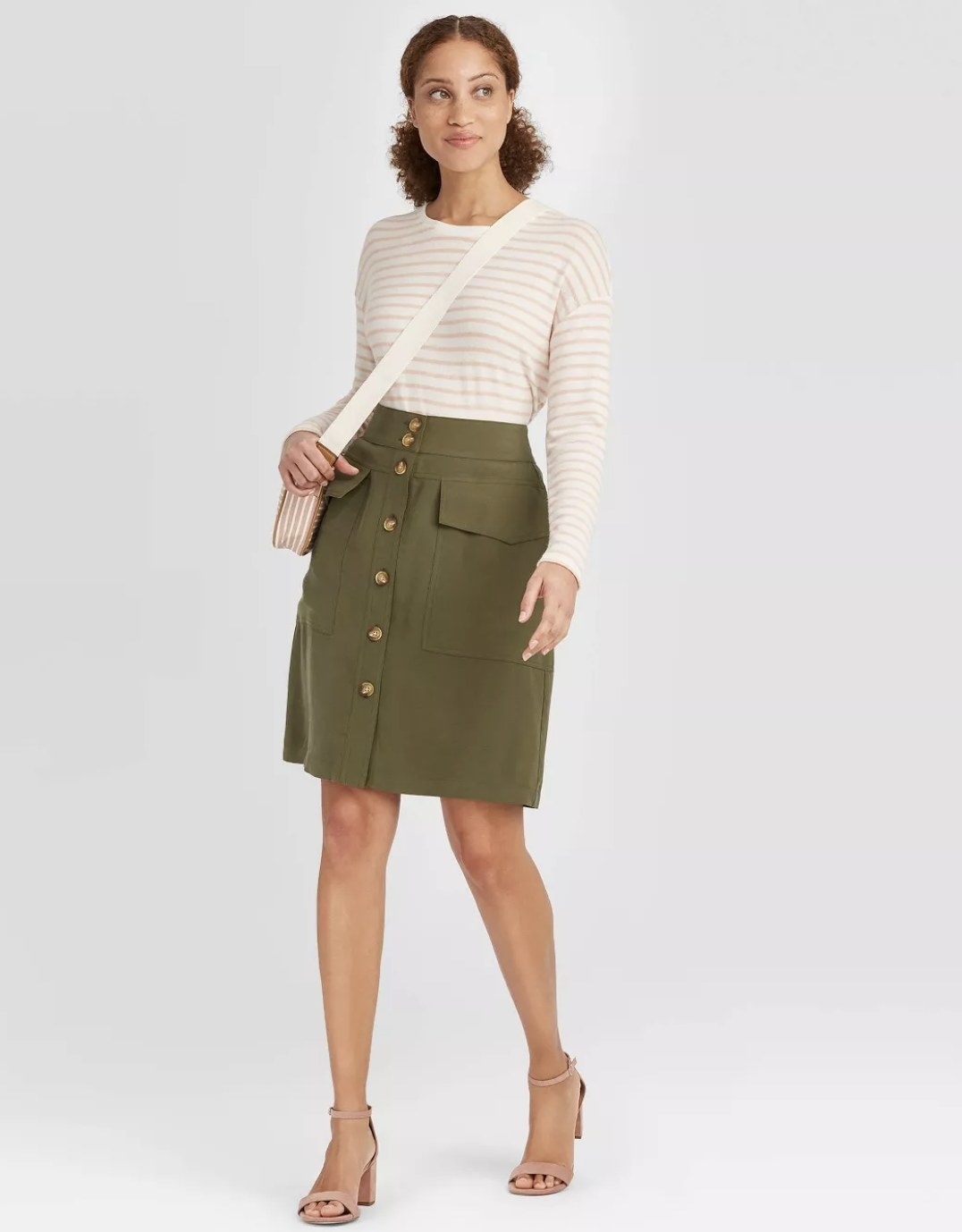 Model wearing the olive green button-down skirt