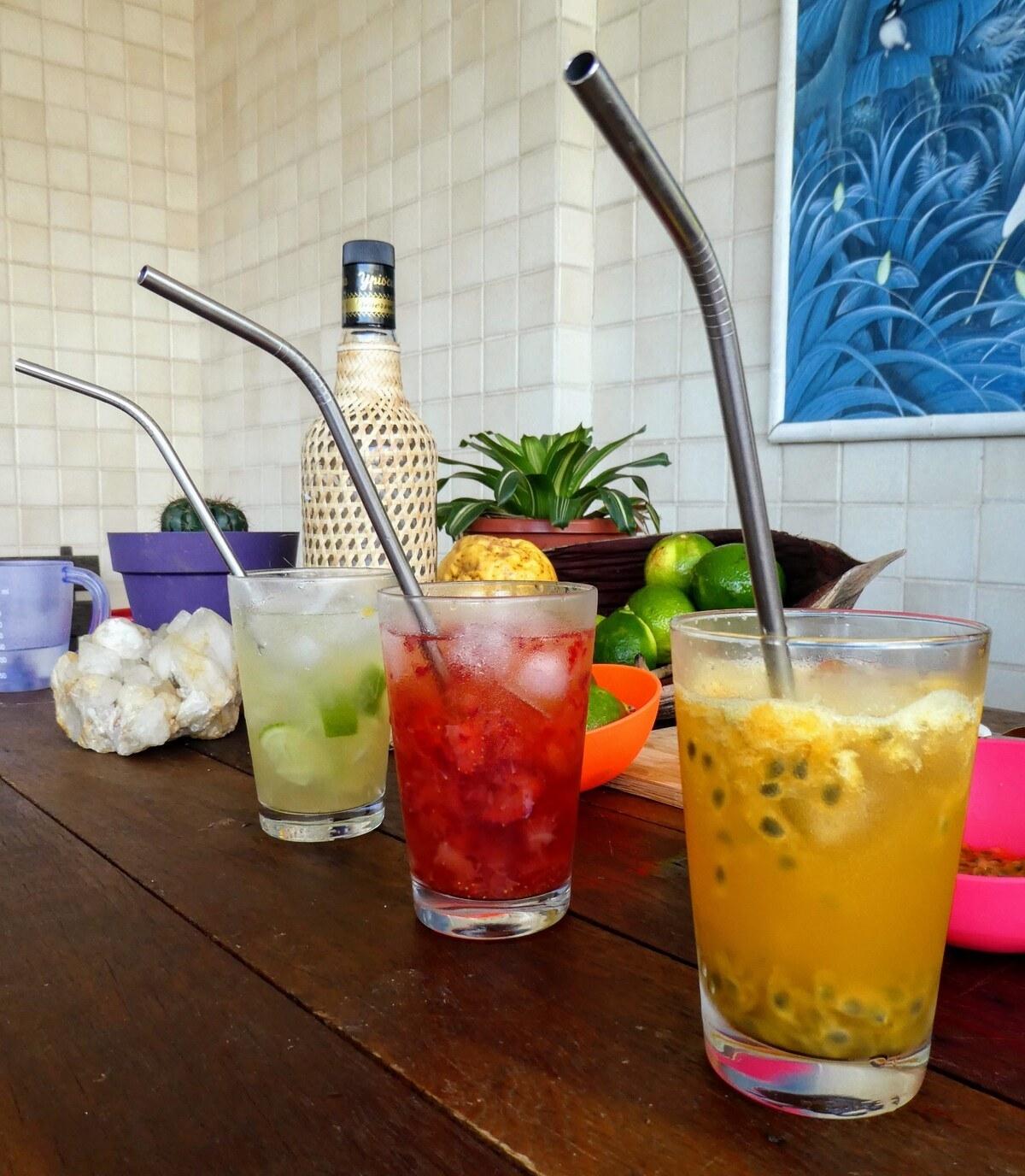 three glasses of fruity caipirinha