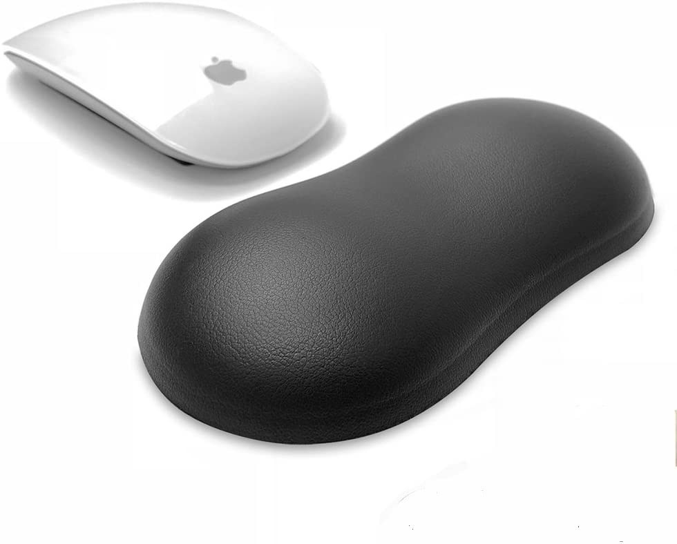 A small round wrist rest sitting next to a wireless computer mouse