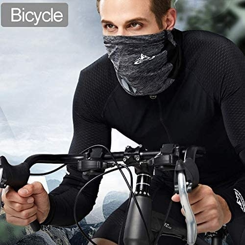 A bicyciist in a gray around the neck face covering that covers their nose, mouth, and neck