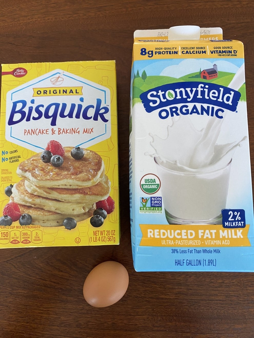 Bisquick pancake mix, milk, and an egg for making batter.