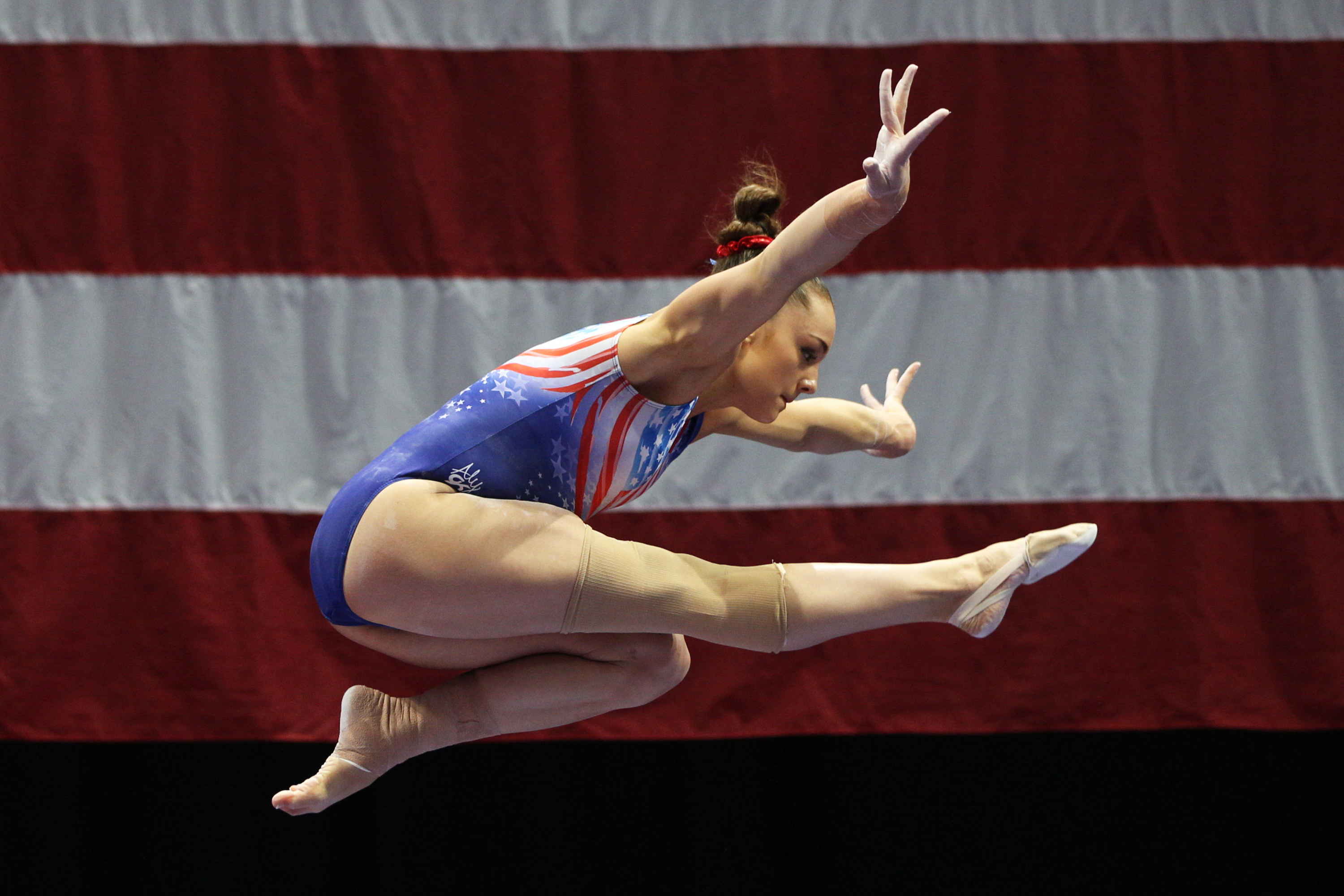 A gymnast in the air.