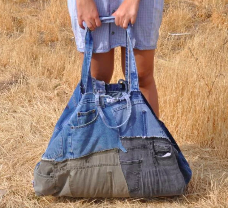A duffle bag sized bag made of recycled denim scraps