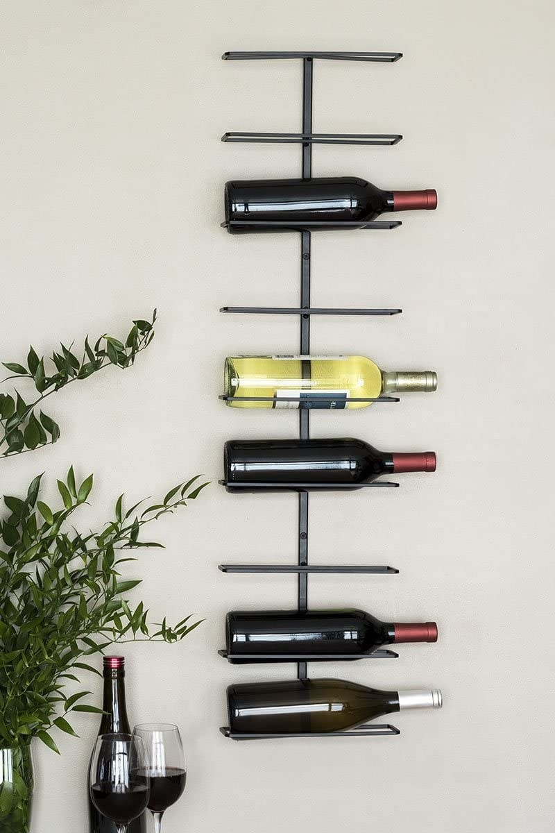 A levelled wine rack with bottles displayed on it
