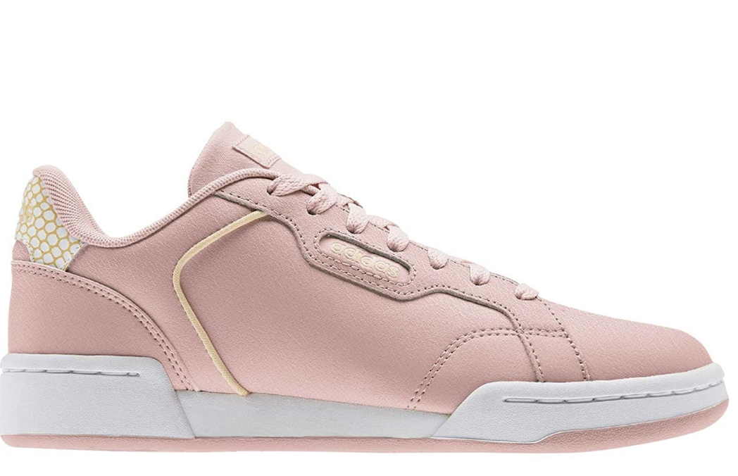 Pink lace up sneakers with pale yellow detailing