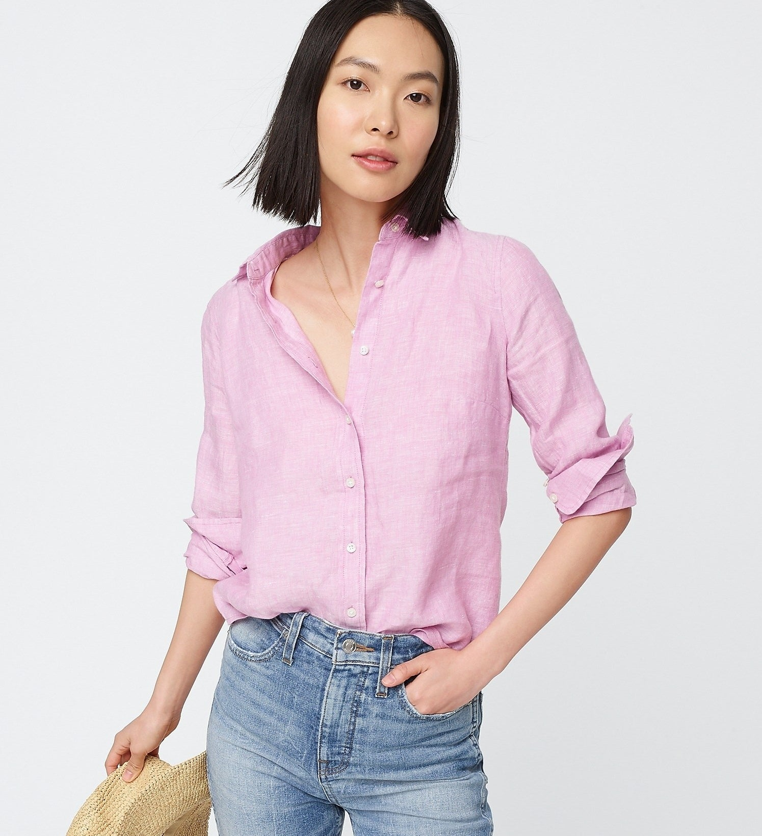 model in pink button up shirt