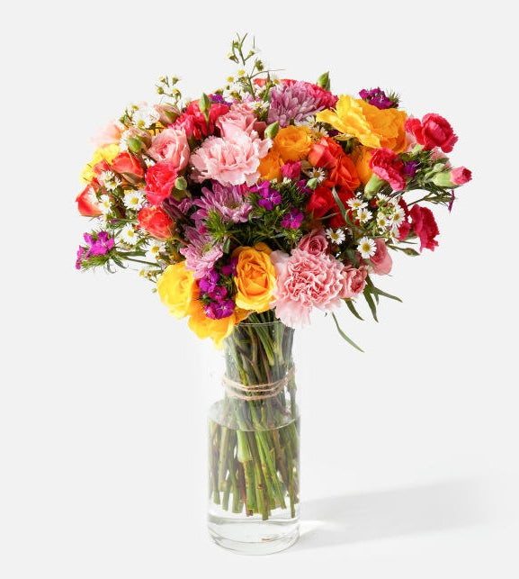 A colorful bouquet of assorted flowers in a vase