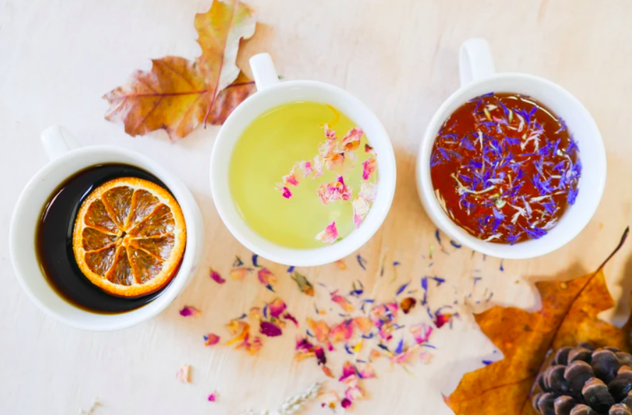 three cups of colorful brewed tea