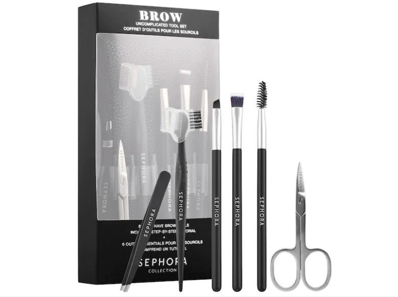 "A black box that says ""Brow Uncomplicated Tool Kit"" with black tools"