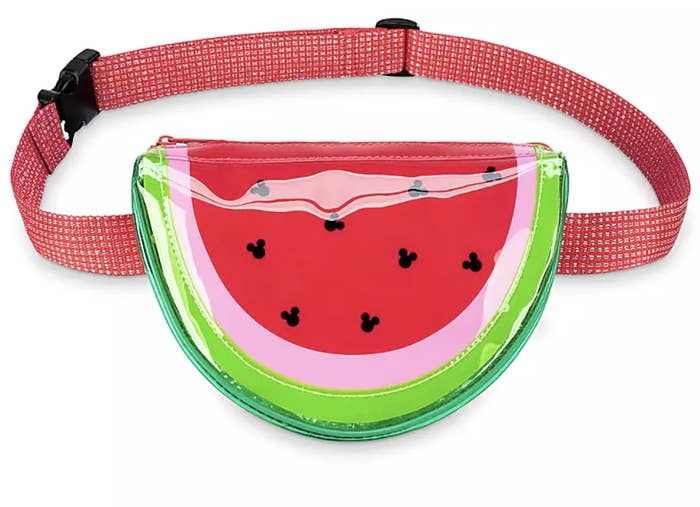 a watermelon shaped fanny pack with black mickey outlines as seeds