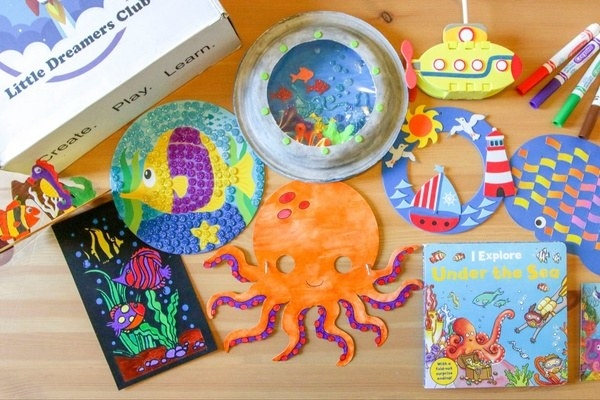 A drawing of an octopus and other crafts, craft supplies, and children's books
