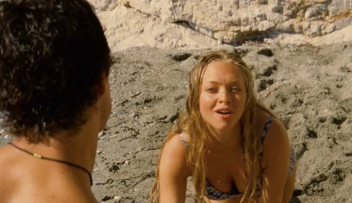 """Sophie from """"Mamma Mia"""" crawling towards Sky in the sand."""