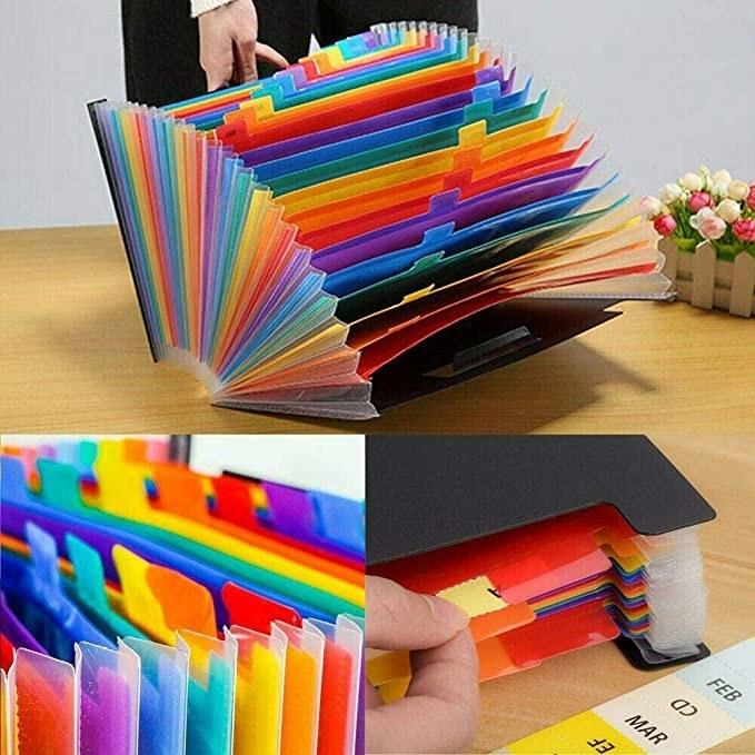 A black folder with rainbow coloured tabs