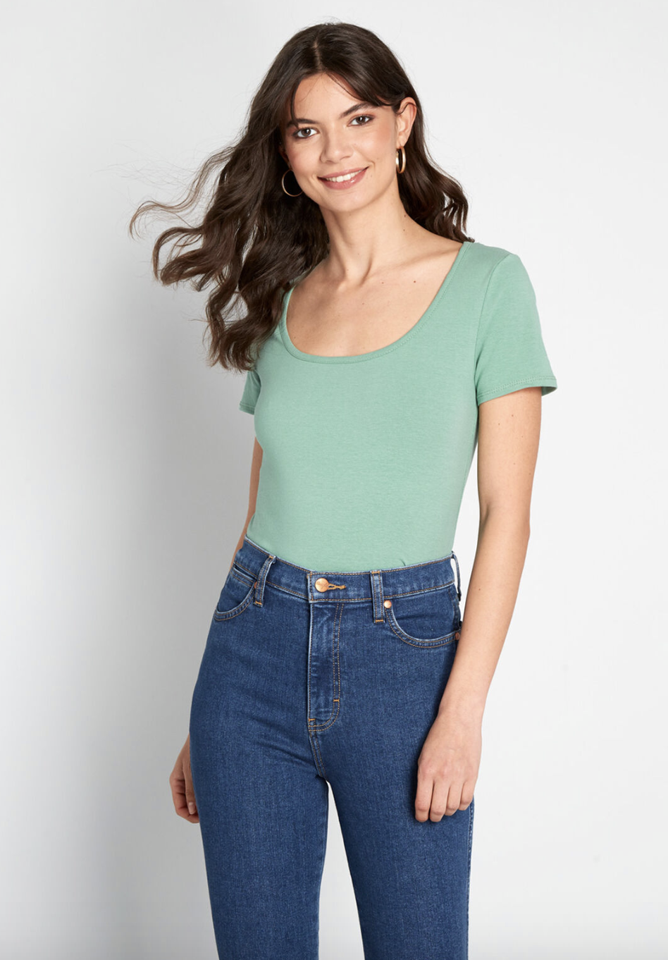 A model in a mint green short-sleeved top
