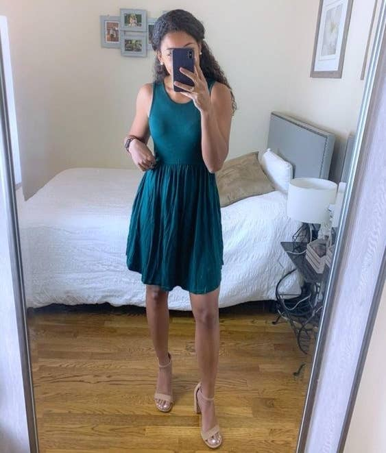 Reviewer wearing the dress in teal