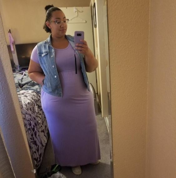 Reviewer in the maxi dress in purple