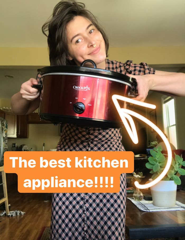 "writer holding red crock pot with caption ""the best kitchen appliance"""