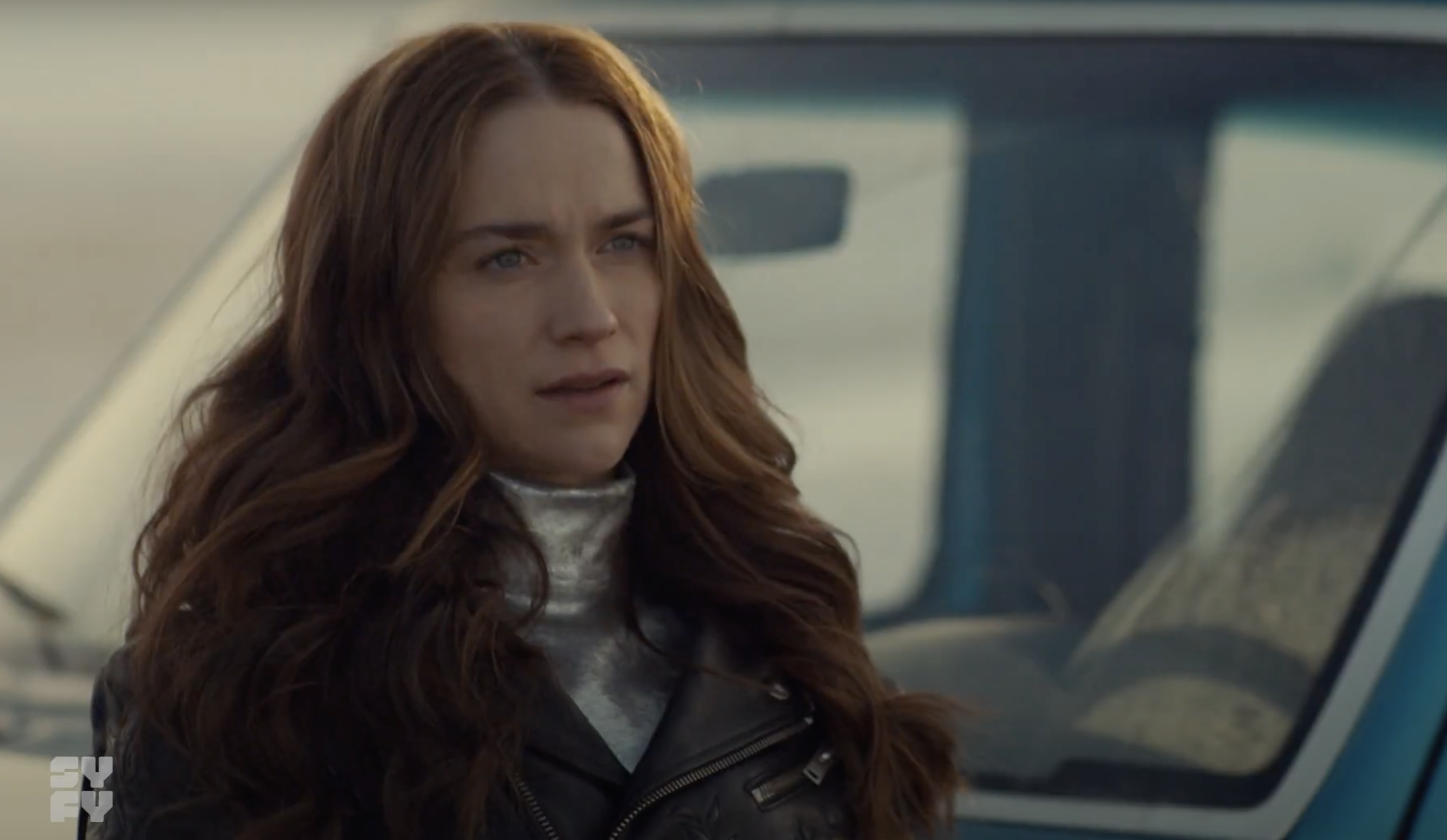 Melanie Scrofano as Wynonna standing in front of her truck during Season 4