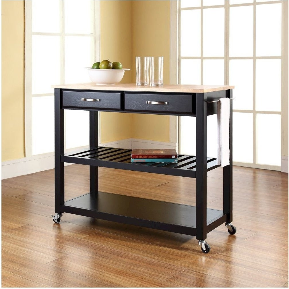 a kitchen island on wheels, the base is black with a middle shelf and two drawers