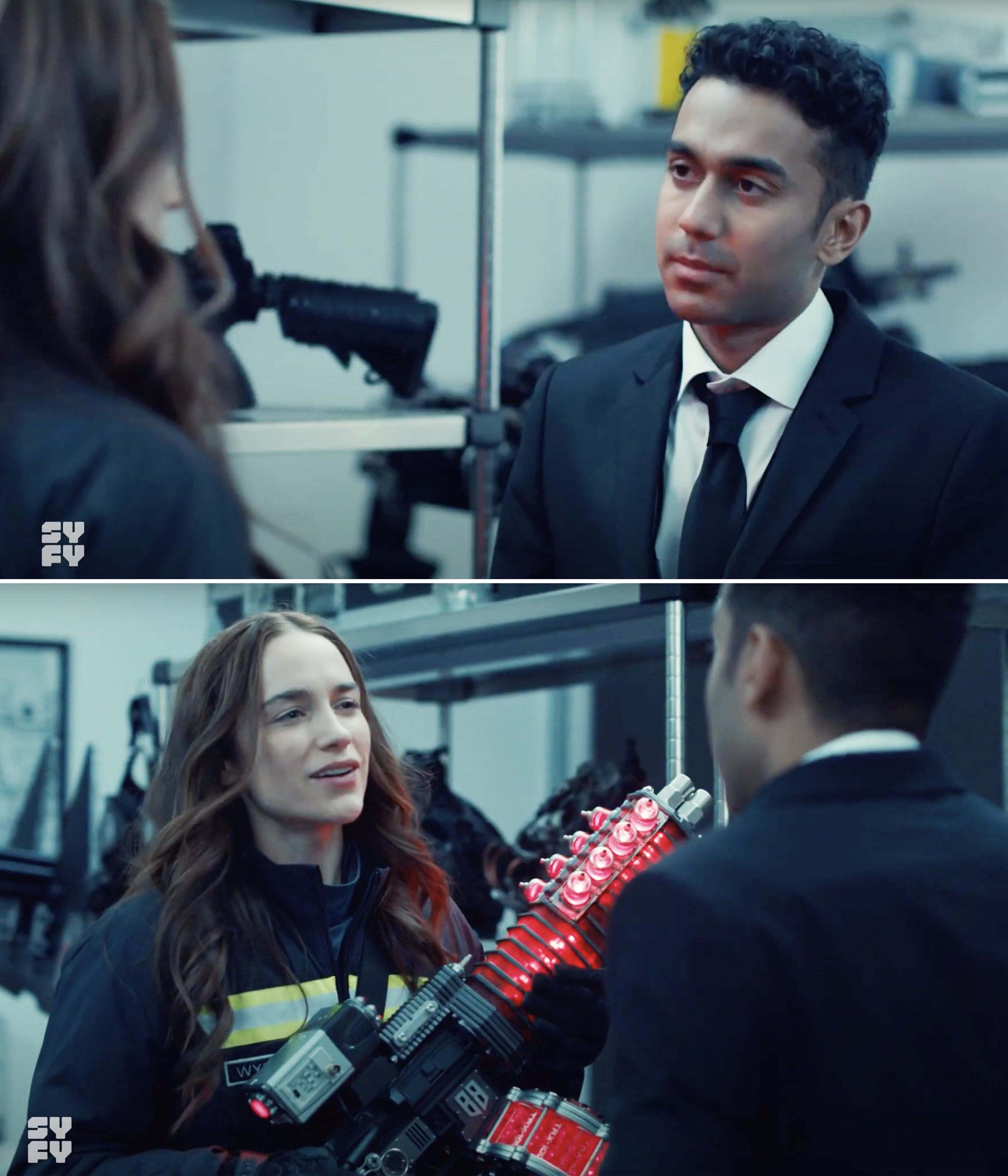 Wynonna holding a giant red gun in front of Jeremy in a suit