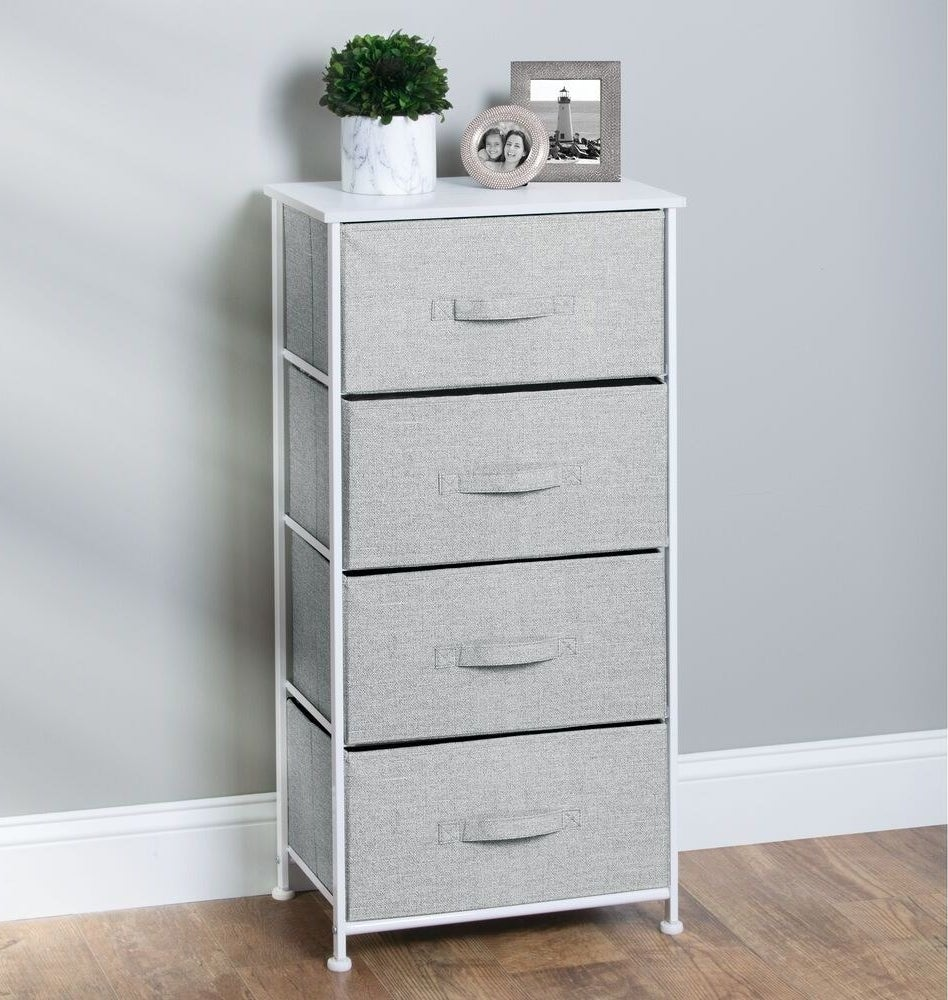 The grey dresser with four fabric shelves