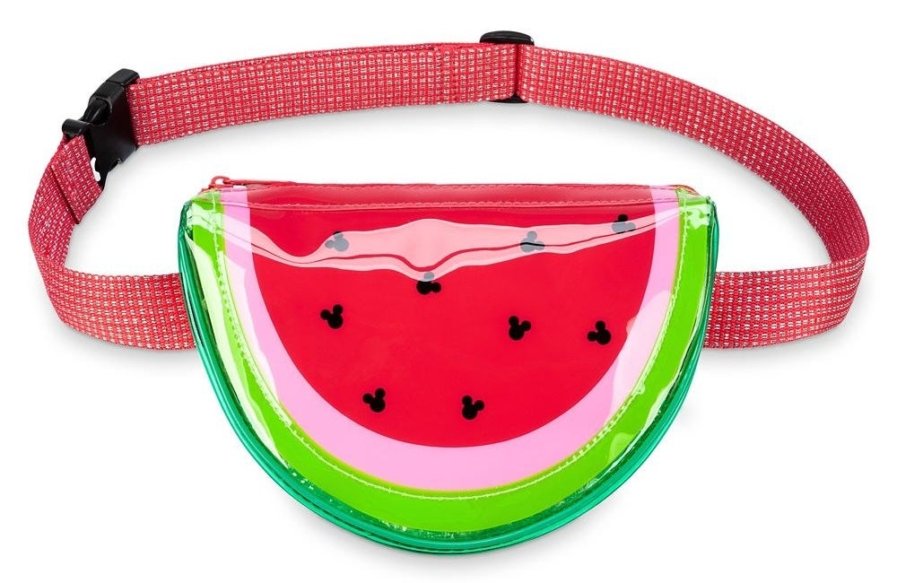 The wedge-shaped bag, featuring an adjustable pink and metallic silver belt strap