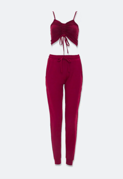 a maroon rouched spaghetti string crop top and matching joggers