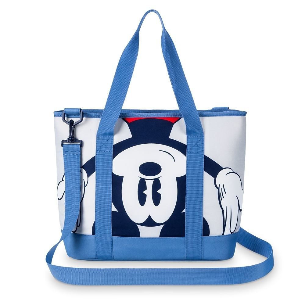 The bag in white and blue, featuring Mickey Mouse screen art, top carry handle and a removable, adjustable shoulder strap