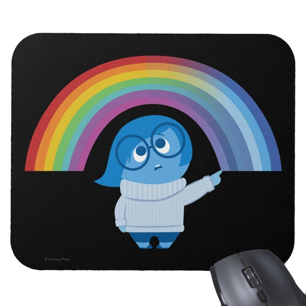 The black mousepad, featuring the character Sadness drawing a rainbow