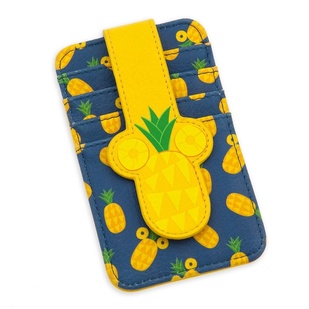 The blue card case, featuring an allover pineapple pattern and a foldover Mickey Mouse pineapple tab with metal snap closure