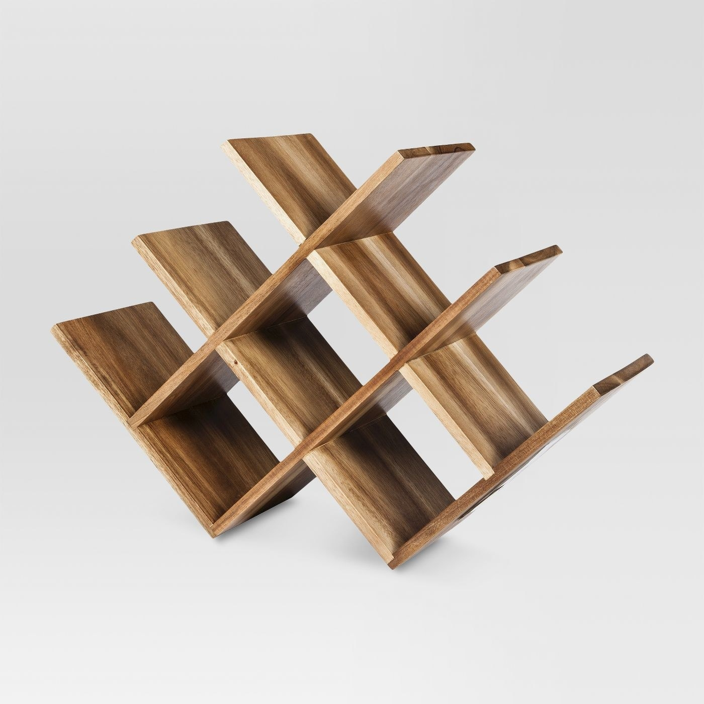 an intricately designed wooden wine rack with spots for eight bottles