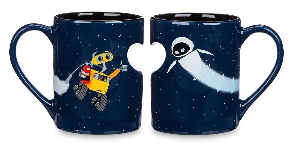 The mugs, featuring a navy space background and heart-shaped indentation