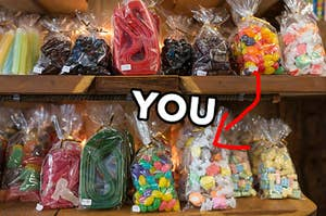 "Old-fashioned candy in plastic bags, including jelly beans, licorice, and hard candies, and a bold arrow points to a bag of salt water taffy with ""you"" typed out next to it"