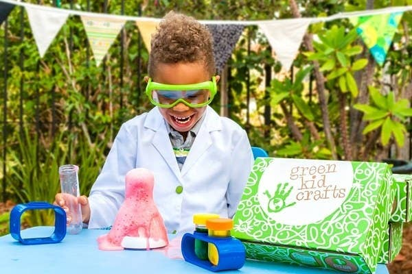 A model playing with a Green Kid Craft volcano project
