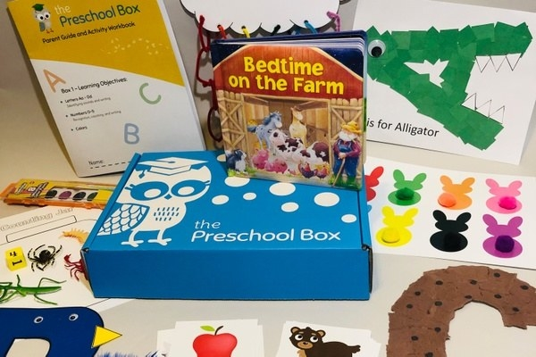 Close up of Preschool Box with children's books, know your letter activities, crafts, and other featured items