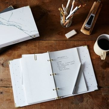 open notebook with recipe written down on a page