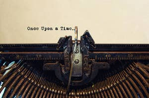 """A typewriter with the words """"Once upon a time"""" on the paper in it"""
