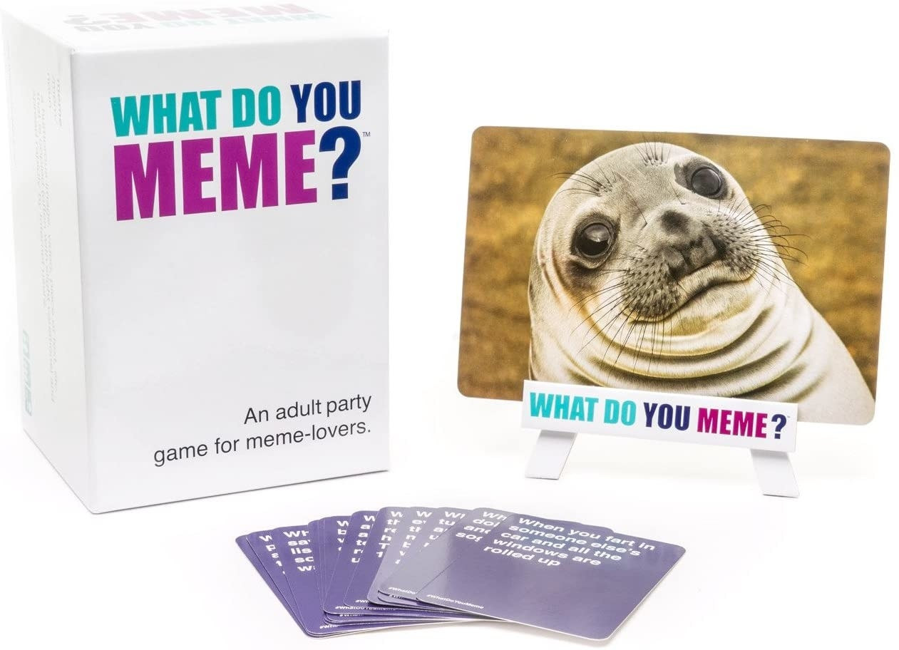 What Do You Meme? card game box with seal meme displayed on stand