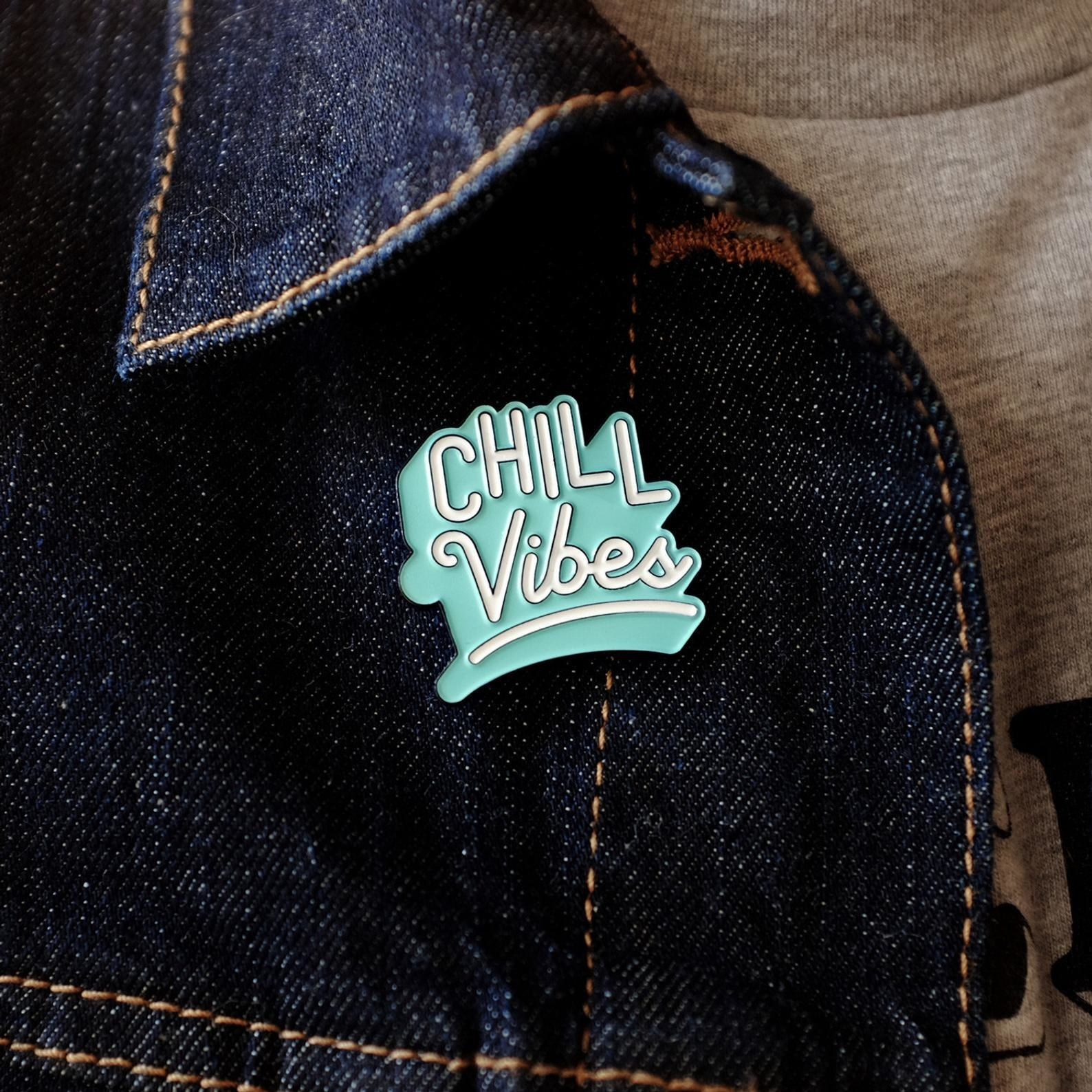 The pin on a denim jacket