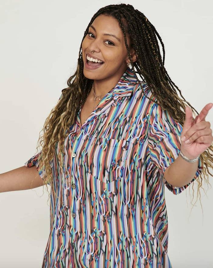 Model wearing the rainbow printed shirt