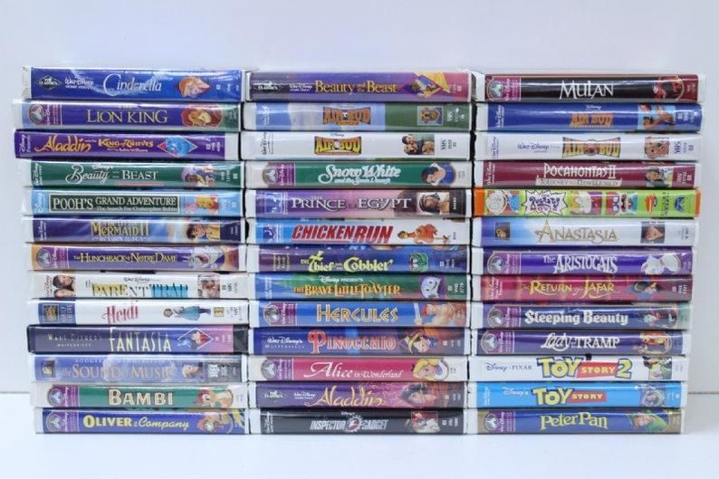 A large collection of clamshell Disney VHS tapes