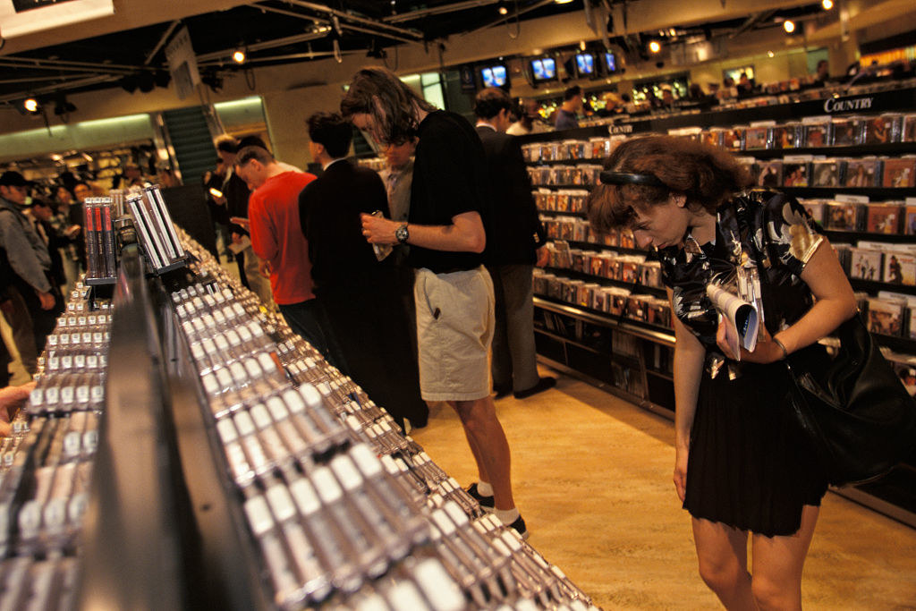 People looking around the CD section of a '90s Virgin Megastore