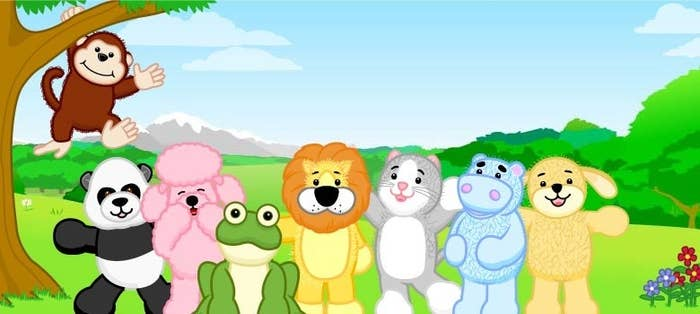 A monkey, panda, poodle, frog, lion, cat, hippo, and dog Webkinz stand outside in a field smiling at the camera