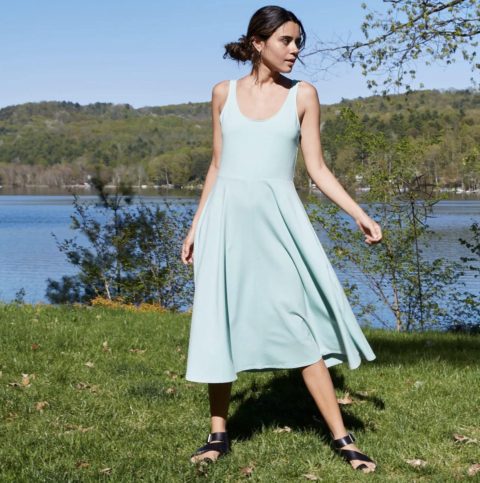 Model wearing the A-line T-shirt dress in light blue