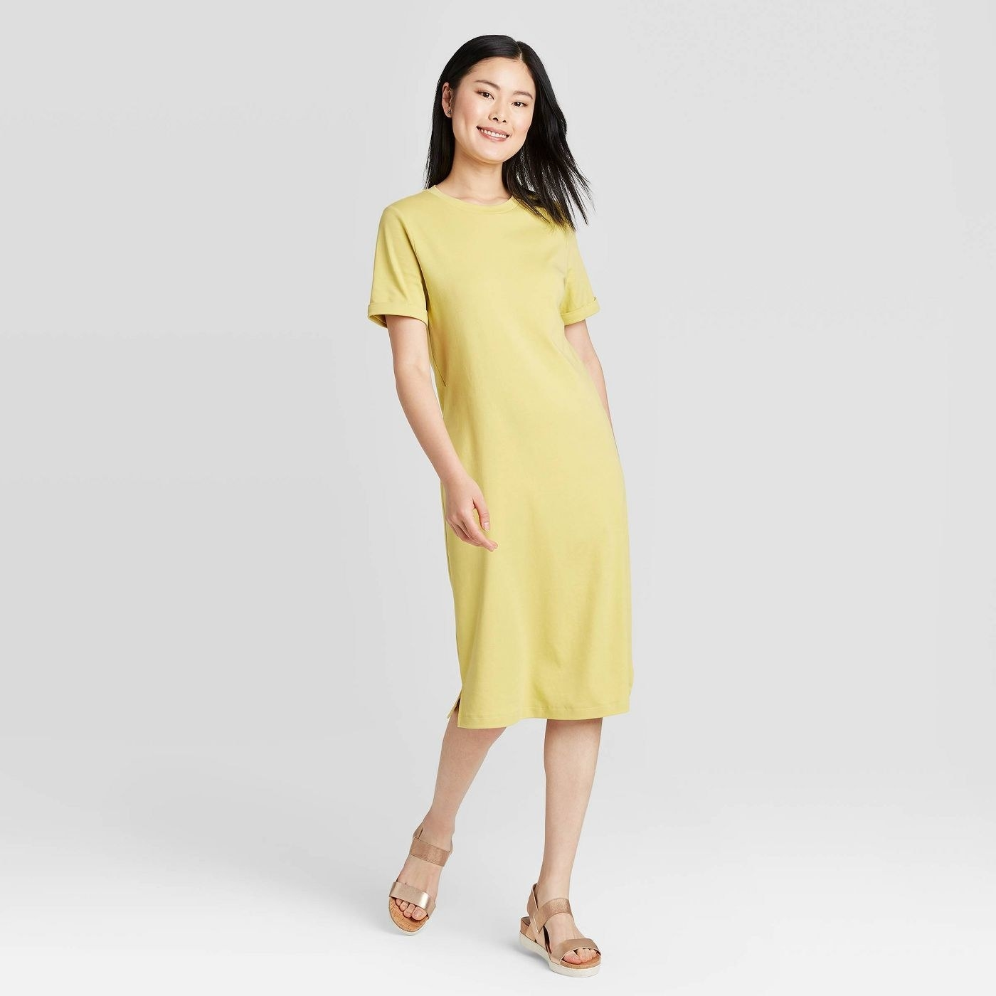 A yellow short-sleeved dress with a hem just below the knee