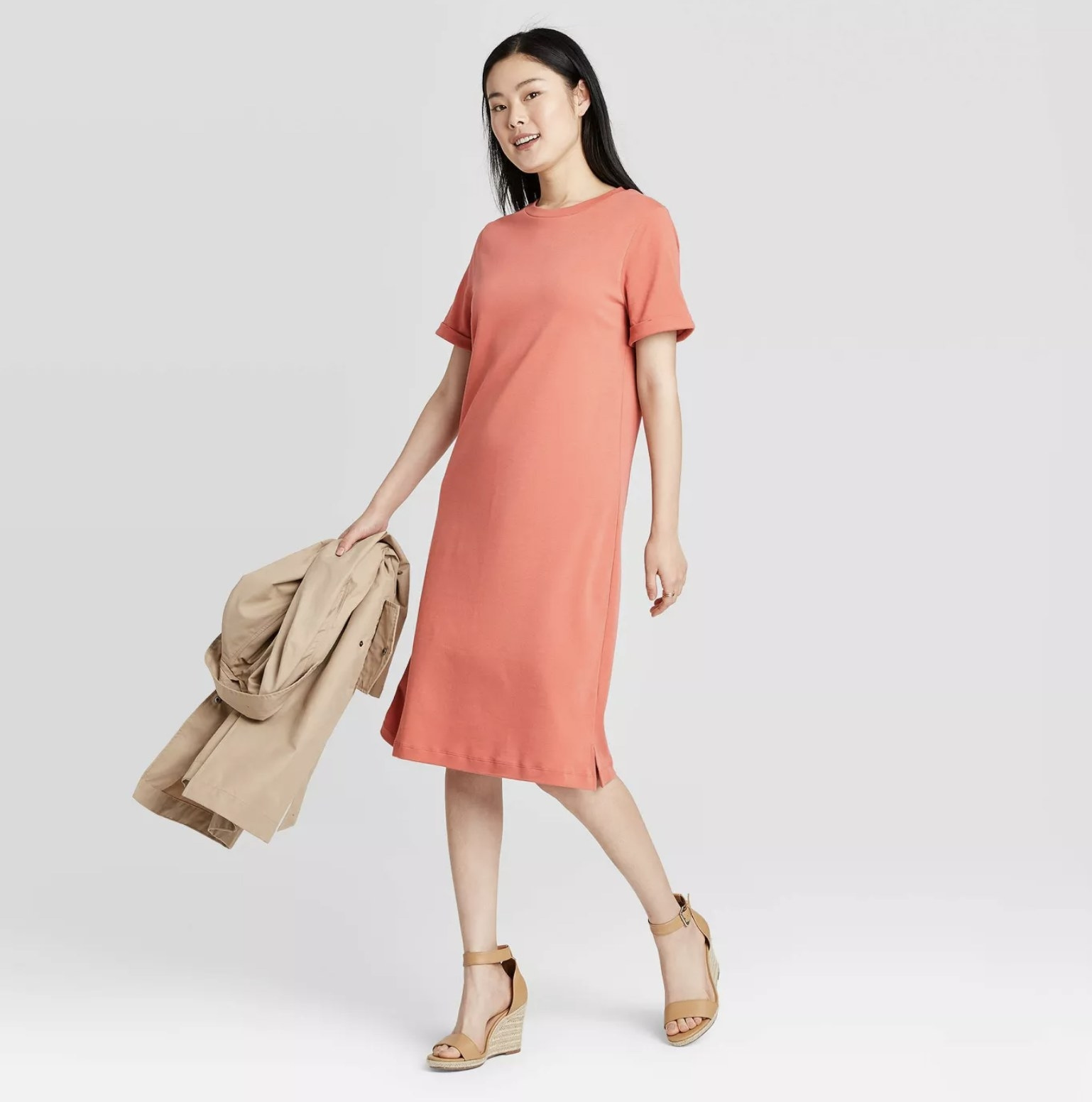 Model wearing the knee-length T-shirt dress in pink