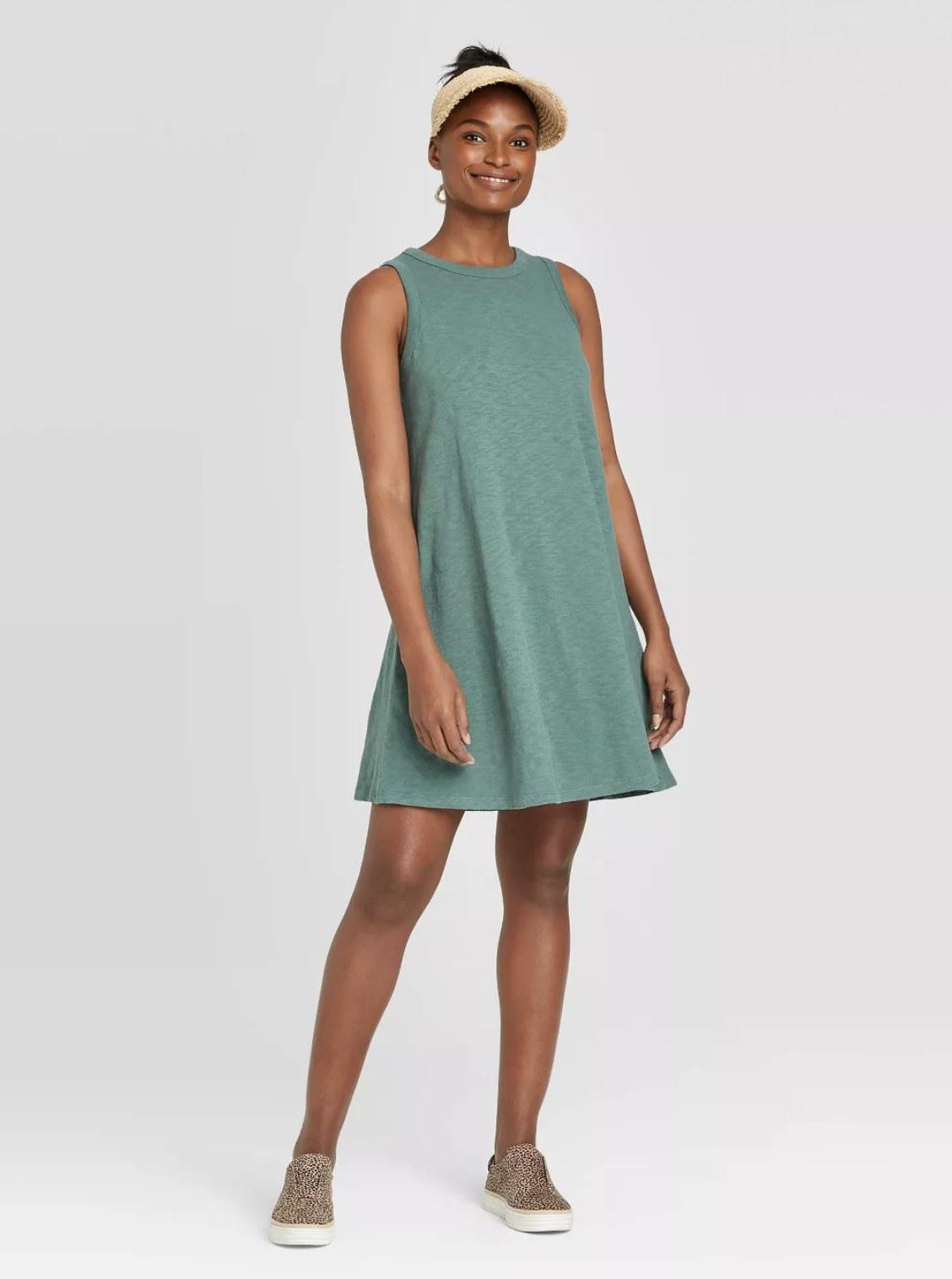 Model wearing the tank dress in teal